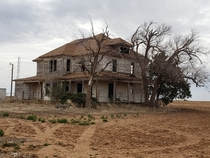 Abandoned house on a hill surrounded by farm land Plainview TX