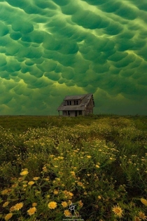 Abandoned House with Dramatic Mammatus Clouds Mayhem by Aaron J Groen