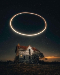 Abandoned house with halo ring above it