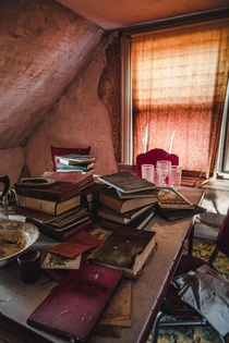 Abandoned house with stacks of books
