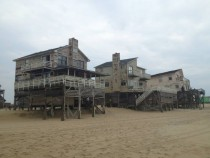 Abandoned houses next to the shoreline Outer Banks NC
