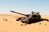 Abandoned Libyan T- tank at Ouadi Doum Chad by Guido Aldi