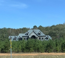 Abandoned mid construction mansion slowly getting swallowed by trees Barnesville Ga
