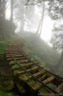 Abandoned mining railway in a clouded forest of Taiwan