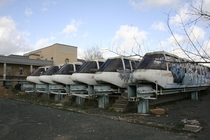 Abandoned monorail cars at Seville Expo  site by Oliver Herbert