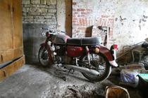 Abandoned motorcycle in old garage North Yorkshire England