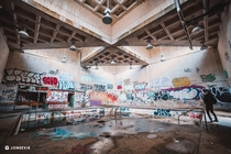 abandoned natatorium left to decay becomes a canvas for vandals