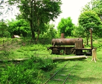 Abandoned old French railroad locomotive I cycled past in Laos OC