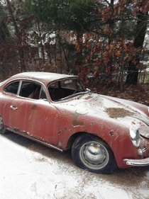 Abandoned old Porsche that is beaten to hell