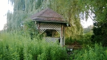 Abandoned overgrown gazebo on a lake island - rural area in Michigan