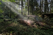 Abandoned Panhard car in the woods in France wwwobsidianurbexphotographycom