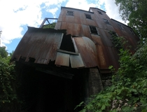 Abandoned paper mill in Ellenville NY There is a water fall which a lot of people go swimming in but I heard the water has chemicals leaking in from the mill Its getting knocked down soon though