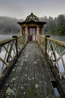 Abandoned Pavilion on a lake Photo by Matt Emmett