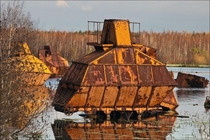 Abandoned peat harvesters somewhere in Russian swamps