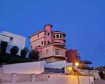 Abandoned pink mansion in the middle of a residential area in Alicante Spain