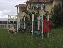 Abandoned playground in childrens section of abandoned insane asylum southern california