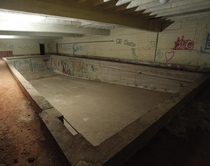 Abandoned pool in the basement of the building I work in Details in comments