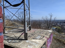 Abandoned radio antenna perched on a cliff in Clifton NJ that I stumbled across on a hike You can faintly see the NYC skyline in the background though unfortunately it was a bit foggy this morning