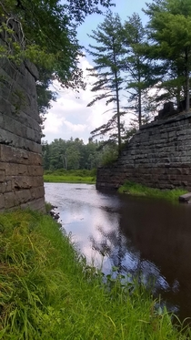 Abandoned rail bridge trestle foundations over the Otter River Winchendon Mass