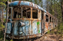 Abandoned rail car in the woods
