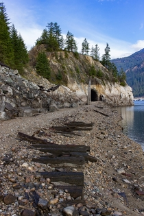 Abandoned rail line along the Columbia River now dammed into the Arrow Lakes Reservoir west of Castlegar BC