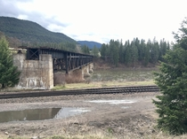 Abandoned  railroad bridge over the Clarks Fork River near St Regis Montana USA Approaches removed