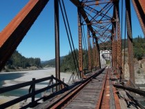 Abandoned railroad bridge over the Eel River near Humboldt Redwoods State Park CA