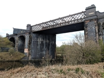 Abandoned Railway Viaduct with  shipping containers on