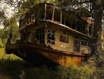 Abandoned river boat the Mamie S Barret On the banks of the Mississippi