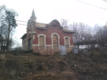 Abandoned s station building Pokrovskoye-Streshnevo Moscow Russia photo is taken from a trains window passing