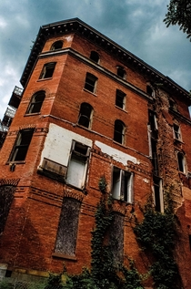 Abandoned sanitarium Has a large slice down the side of it