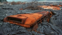 Abandoned school bus engulfed in volcanic rock