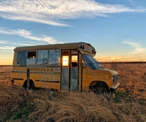 Abandoned school bus rural highway near Graford Texas