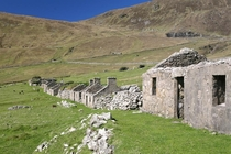 Abandoned Scottish island of St Kilda - A row of abandoned cottages on the island - It is now a tourist destination in Summer