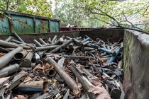 Abandoned scrap yard full of old war equipment