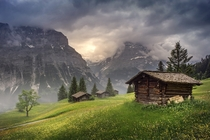 Abandoned Shacks in the Rolling Hills of Upper Grindelwald Switzerland  by Brock Whittaker