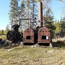 Abandoned steam engine in Allagash Maine Used to power a tram way that pulled logs from one lake to another to be floated to saw mills in the southern part of the state