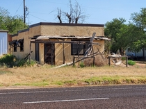 Abandoned store whitching posts Dickens TX