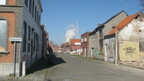 Abandoned street with working Nuclear Plant in background Doel Belgium