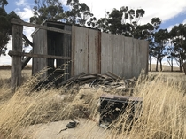 Abandoned swimmers changing hut in the middle of a paddock where a once in  year creek forms Rural Australia