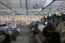 Abandoned Textile Factory cotton still in the machines