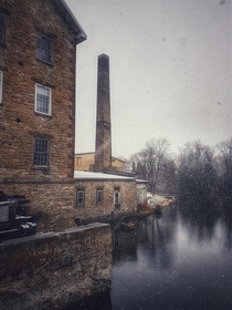 Abandoned textile mill in a snowstorm OC