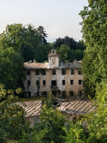 Abandoned th-century Italian estate enclosed by green wilderness