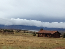 Abandoned timber house after the storm Ghost Ranch NM
