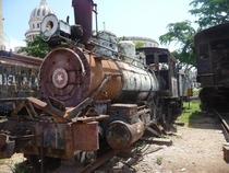 Abandoned train with El Capitolio in background Havana Cuba