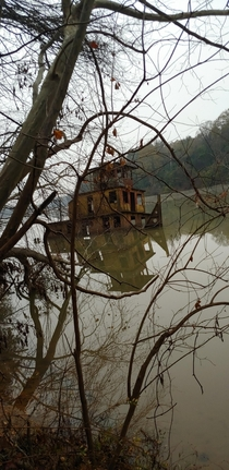 Abandoned tug boat I found while walking along a river in Columbus GA