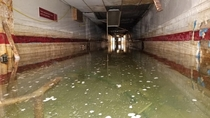 Abandoned underground personnel tunnel full of water