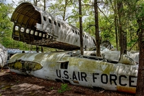 Abandoned US Air Force fighter jets and plane fuselage photo by Cindy Vasko