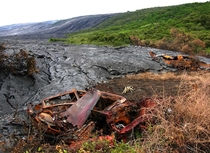 Abandoned vehicles are consumed by lava at the Royal Gardens near the base of the Pali