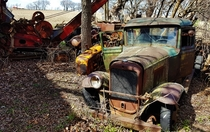 Abandoned vintage truck among other rusty friends on a farm in rural Franklin GroveIL By Bill